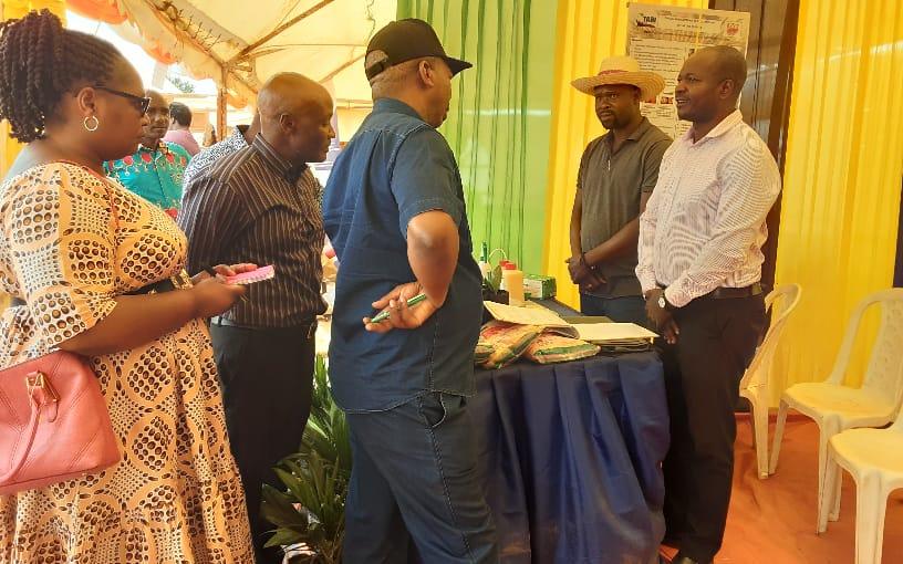 Rukwa Regional Commissioner Hon. Joseph Mkirikiti speaking to TARI Researchers today 26/9/2021 after visiting the TARI pavilion at ongoing  third SIDO national exhibition