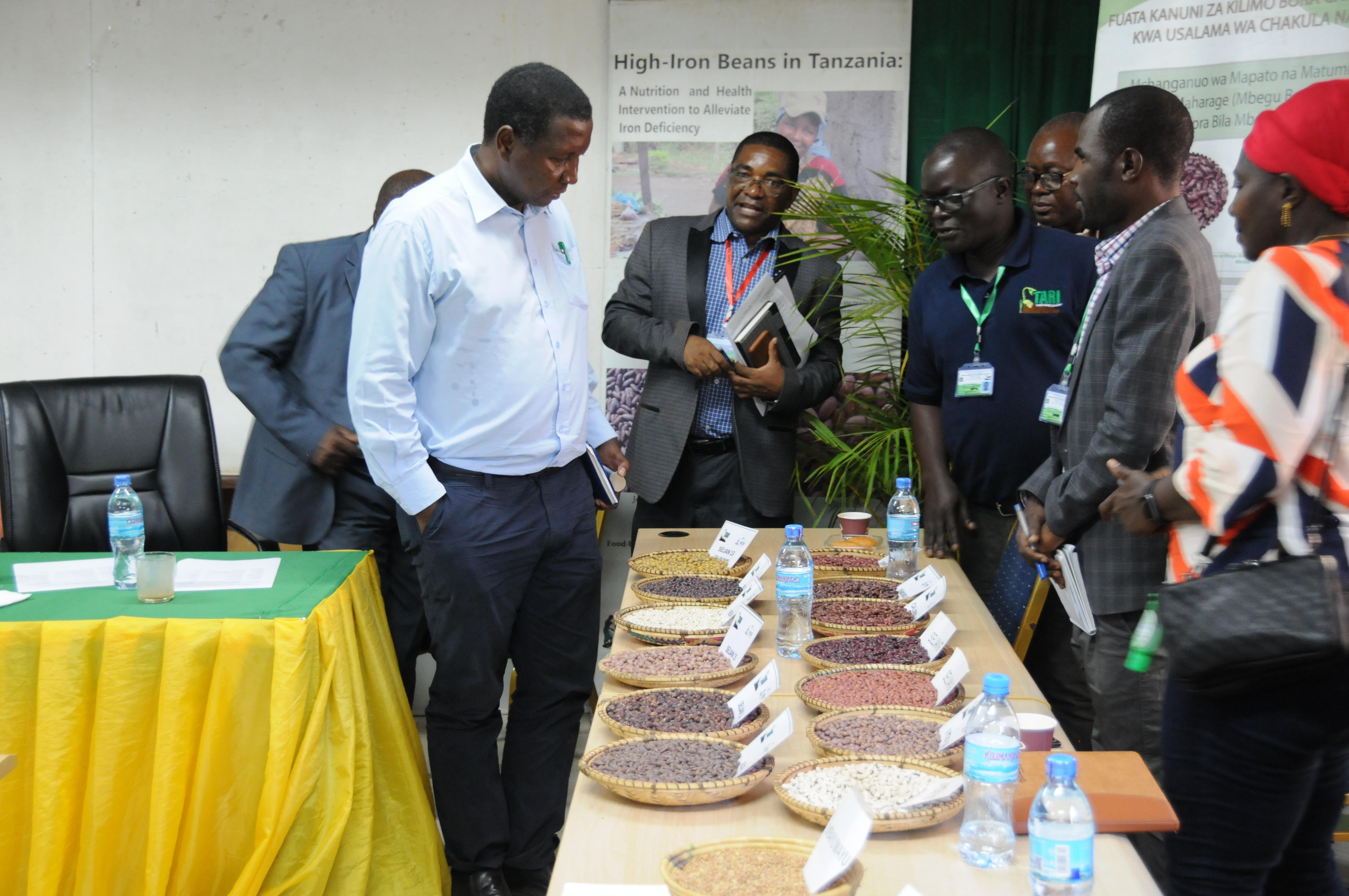 Professor Adolf Mkenda, Minister of Agriculture attentively listening the comprehensive information on bean varieties during his tour at TARI Selian on 17/04/2021