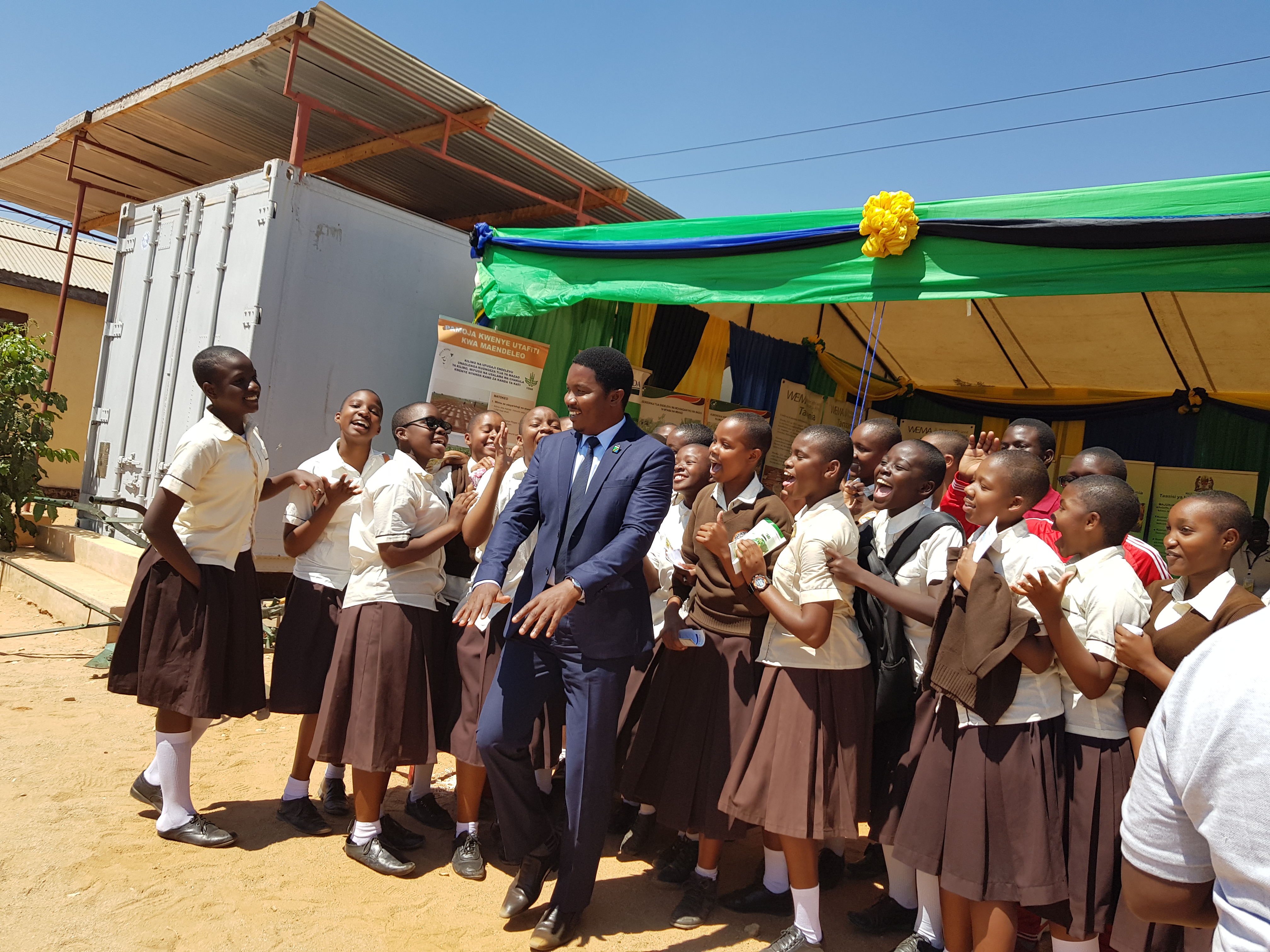 The Minister of State President's Office Regional Administration and Local Government Hon Suleiman S Jaffo pose a memory picture with Dodoma secondary school students (future scientists) who visited TARI-Makutupora pavilion during Nanenane festivals for l
